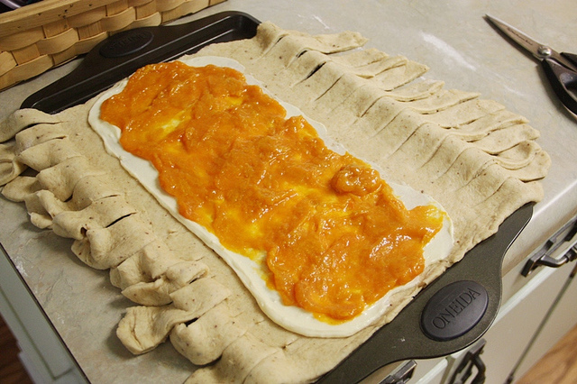 Homemade Apricot  Yeasted Coffeecake filling on dough