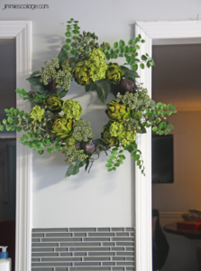 artichoke and fig wreath on kitchen wall {wreath is courtesy of silkplantsdirect.com}